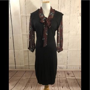 Black dress with faux blouse.